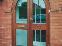 Mahogany semicircular entrance doors