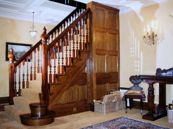 Double Staircase in stained Mahogany 5-1 | Newmark Furniture